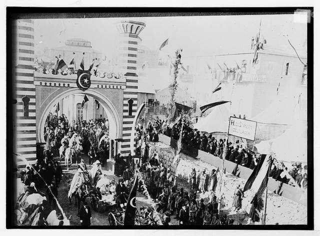 State visit to Jerusalem of Wilhelm II of Germany in 1898. Emperor passing through arch; Hotel D'Europe in background.