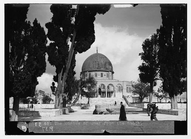 The Temple area. Jerusalem. The Dome of the Rock. (South façade, showing the ablution basin through the cypress trees)