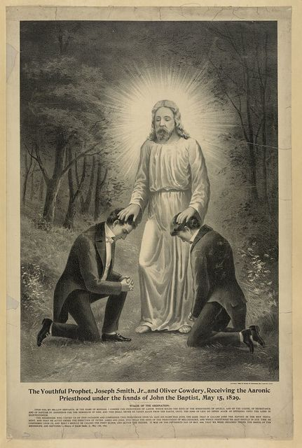 The youthful prophet, Joseph Smith, Jr., and Oliver Cowdery, receiving the Aaronic priesthood under the hands of John the Baptist, May 15,1829