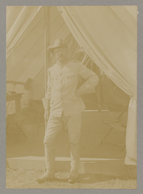 [Theodore Roosevelt, full-length portrait, standing outside his tent, facing front]