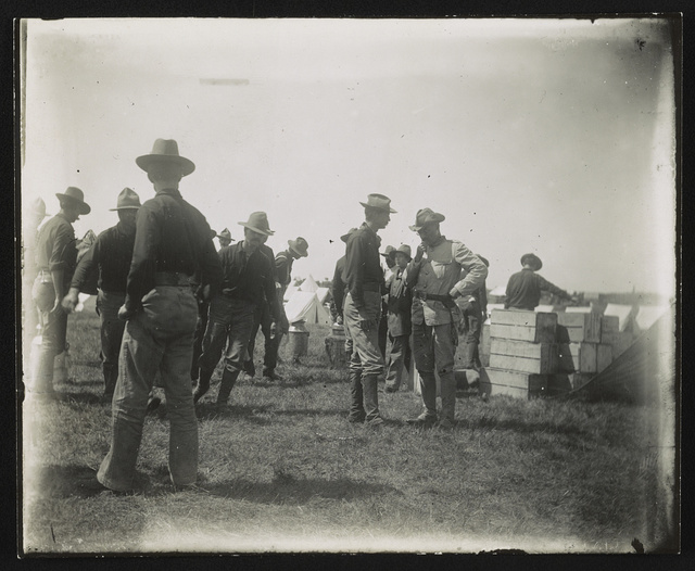 [Theodore Roosevelt in conference, Rough Riders military camp, Montauk Point, New York]