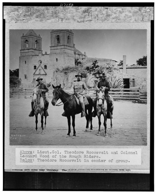 [Theodore Roosevelt posed on horseback, in uniform, between two other men also on horseback, in front of church San Antonio, Texas, during the Spanish-American War]