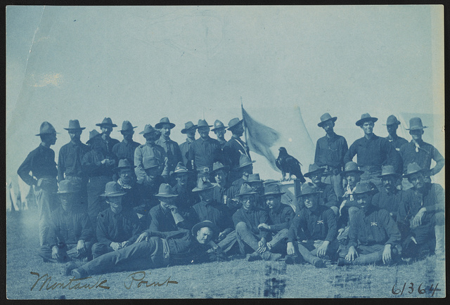 [Theodore Roosevelt's Rough Riders, enlisted men and bird mascot, at military camp, Montauk Point, New York]