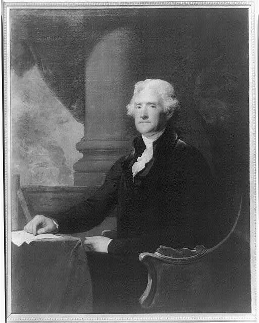 [Thomas Jefferson, three-quarter length portrait, seated at table, facing left]