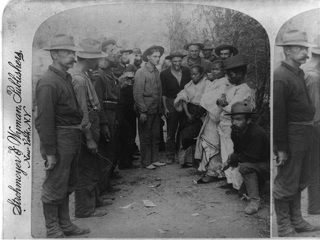 A welcome to Uncle Sam's protection - three Filipinos entering American lines, Pasay, P.I.