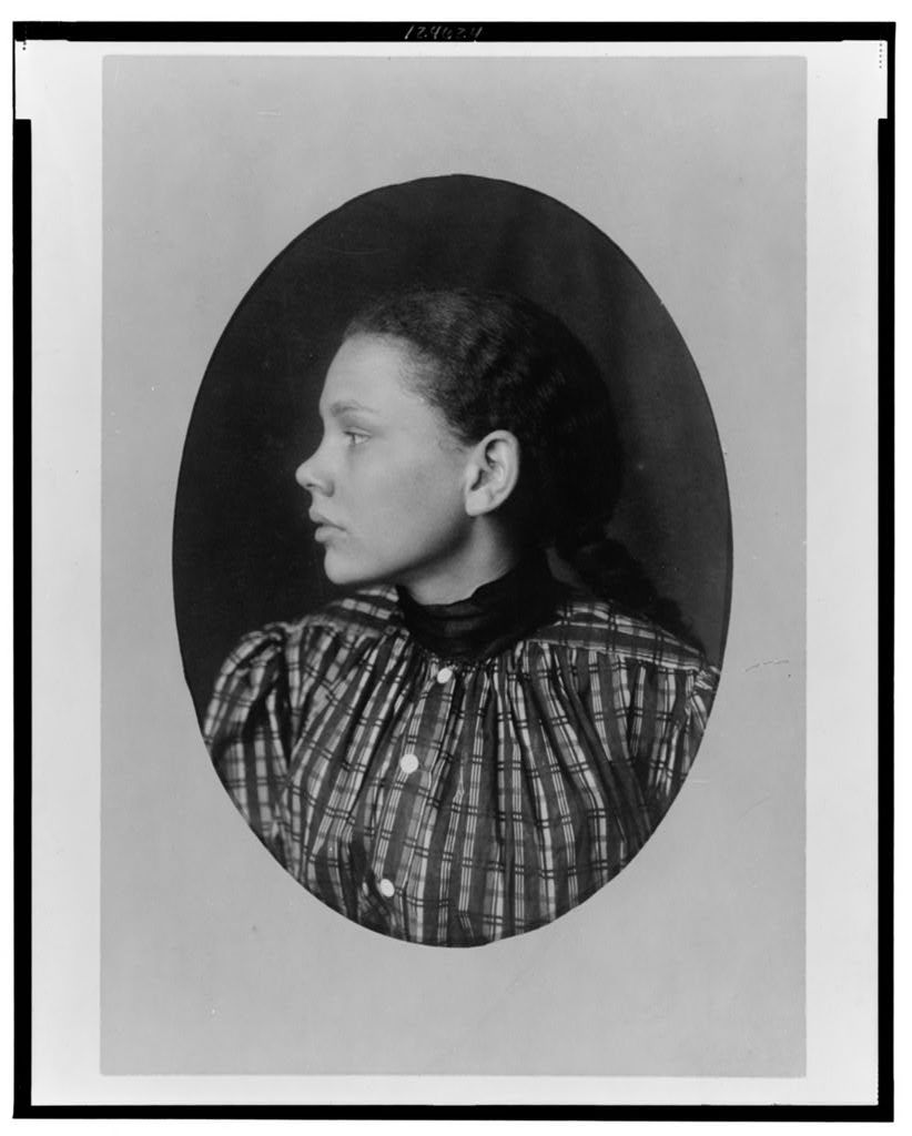 [African American girl, head-and-shoulders portrait, left profile]