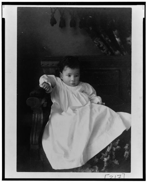 [African American infant, seated in chair, facing front]