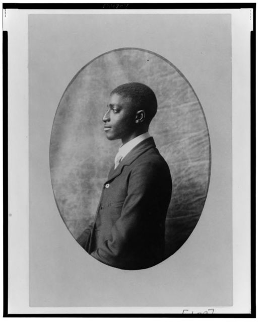 [African American man, half-length portrait, left profile]