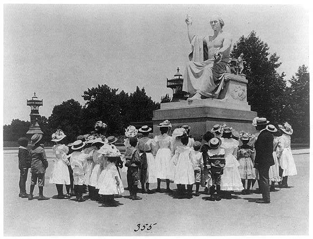 [African American school children facing the Horatio Greenough statue of George Washington at the U.S. Capitol]