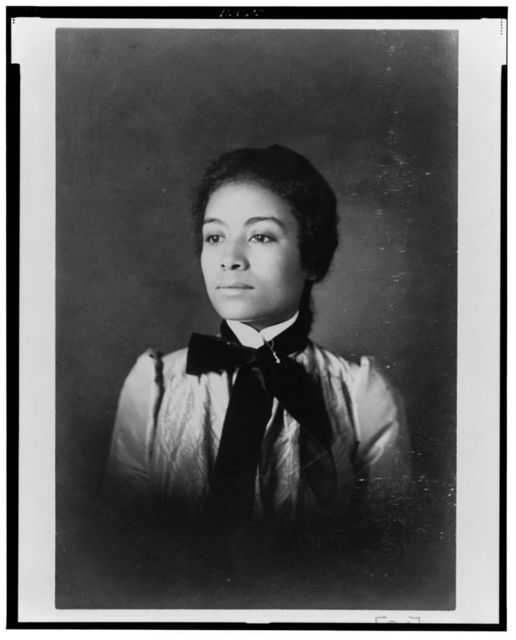 [African American woman, head-and-shoulders portrait, facing left]