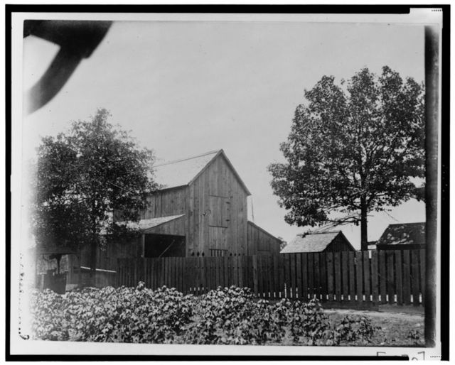 [Barn and other buildings behind fence in Georgia]
