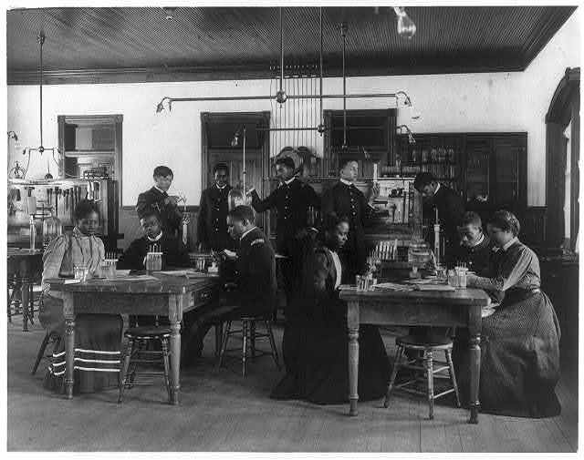 [Chemistry classroom at Hampton Institute - African American male and female students, one Indian]