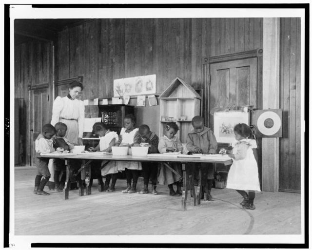 [Eight African American children, in kindergarten, learning washing and ironing at Whittier Primary School, Hampton, Virginia]