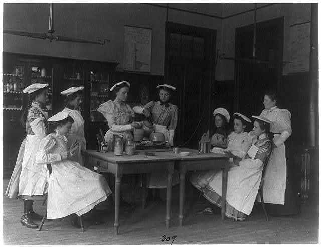[Eight girls and teacher in a cooking class in a Washington, D.C., high school]
