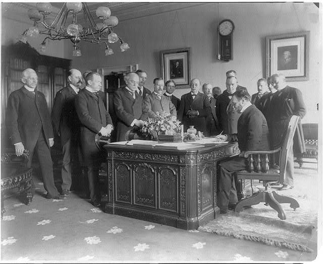 Exchange of the ratifications of the treaty of peace with Spain, made in the President's office, White House, Secretary of State John Hay signing