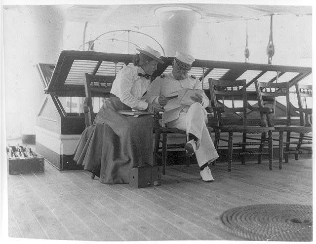 [Frances B. Johnston and Admiral Dewey on the deck of the U.S.S. Olympia]