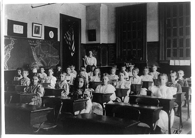 [Grade school children posed in classroom, with teacher standing in back of room, Washington, D.C.]
