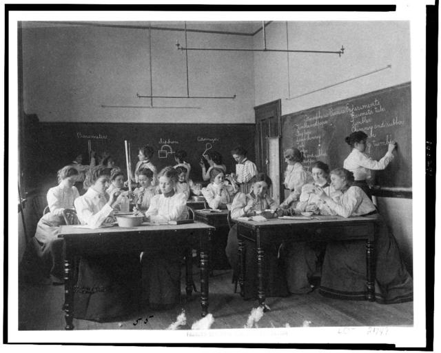 [Group of young women performing atmospheric pressure experiments while studying science in normal school, Washington, D.C.]