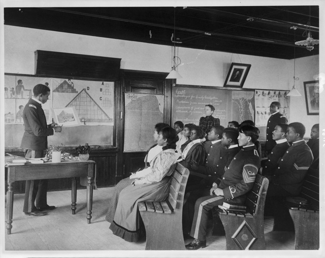 [Hampton Institute, Hampton, Va., 1899 - male and female African American and Indian students in Ancient History class  studying Egypt]