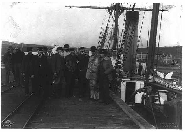 [Harriman Expedition personnel posed on dock in Alaska]