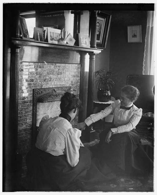 [Katharine Wright and Harriet Silliman, seated near the fireplace]