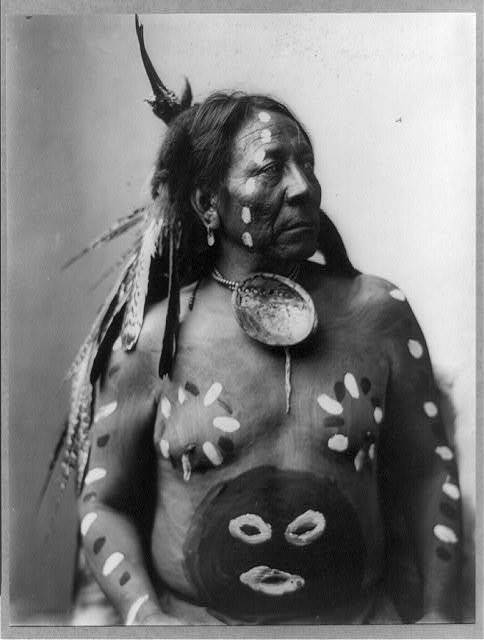 [Last Horse, half-length portrait, facing right; wearing body paint and feathers in his hair]