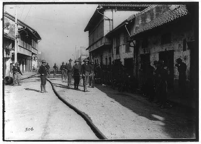 Minnesota & 23rd Infantry guarding burned district