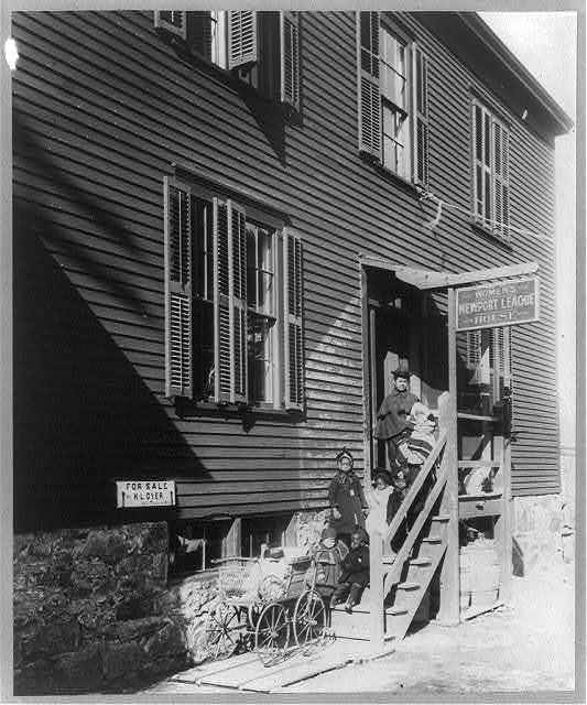 Negro woman and children on steps of day nursery of Women's League, Newport, R.I.