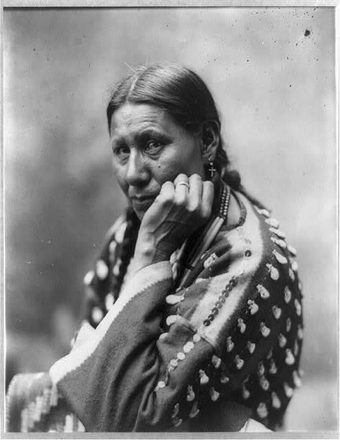 [Philomen Turning Hawk, half-length portrait, seated, facing left; left hand under chin]