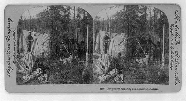 Prospectors preparing camp, interior of Alaska