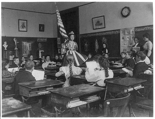 [Public school students in art class sketching live model wearing stars-and-stripes dress and holding U.S. flag, 3rd Division Washington, D.C.]