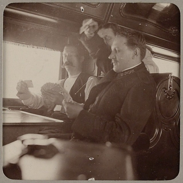 Sousa Band members playing cards on train