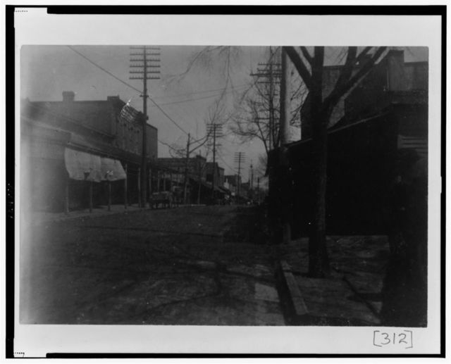 [Street scene showing buildings and power lines in Georgia]