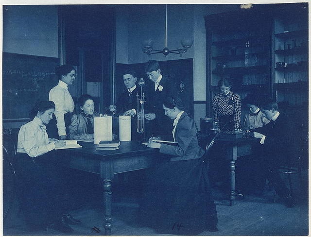 [Students conducting electrical experiments with batteries, Western High School, Washington, D.C.]