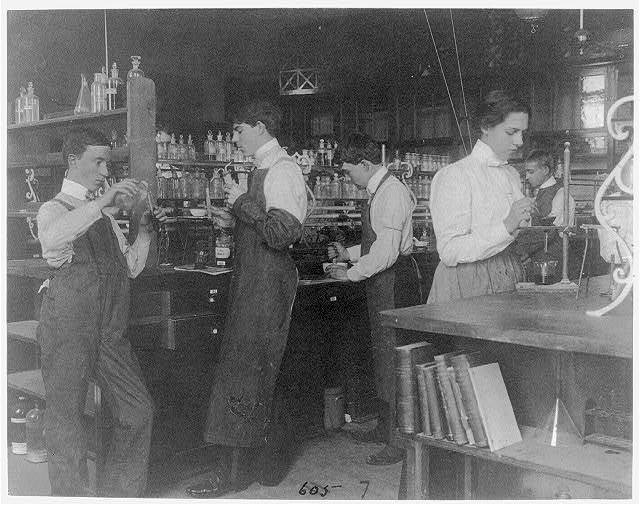[Students in a chemistry class conducting an experiment, Western High School, Washington, D.C.]
