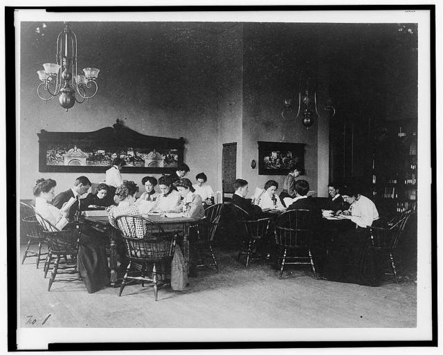 [Students seated around tables, studying, at Western High School, Washington, D.C.]