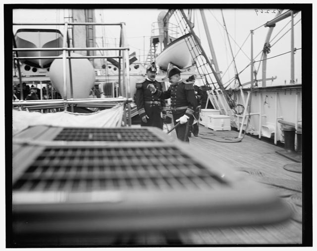 [U.S.S. Chicago, Admiral Schley and Admiral Philip going below]