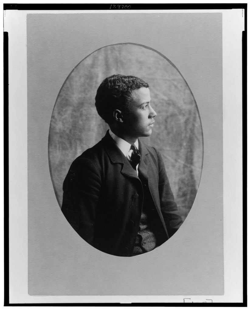 [Young African American man, half-length portrait, right profile]