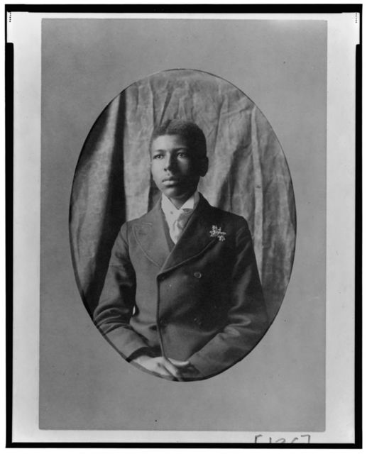 [Young African American man, half-length portrait, seated facing slightly left]