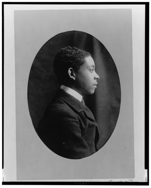 [Young African American man, head-and-shoulders portrait, right profile]