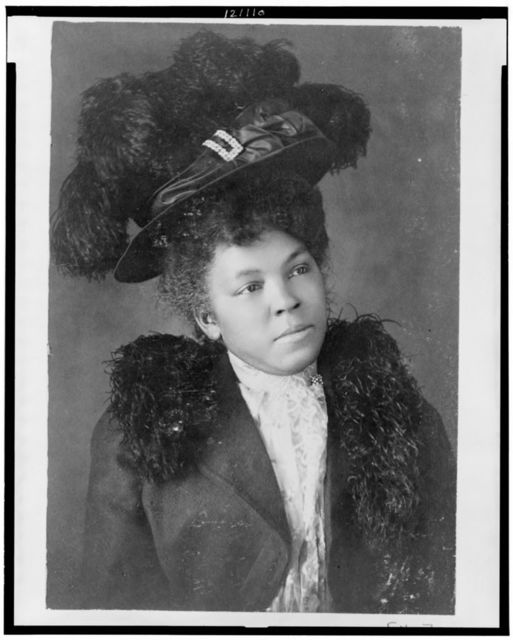 [Young African American woman, half-length portrait, facing right, wearing hat]