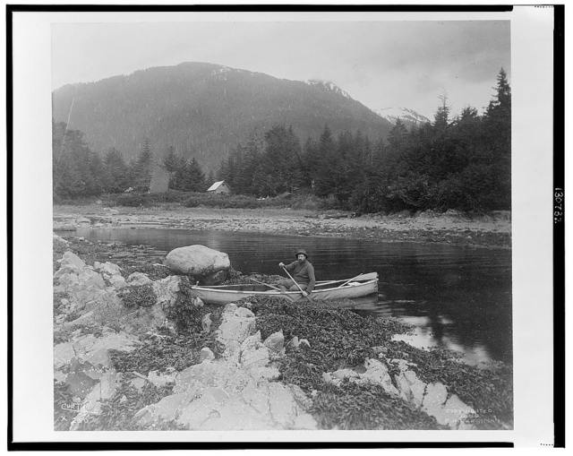 [A man, possibly Lewis Rutherford Morris, seated in a canoe on a river in Alaska, 1899] / Curtis.