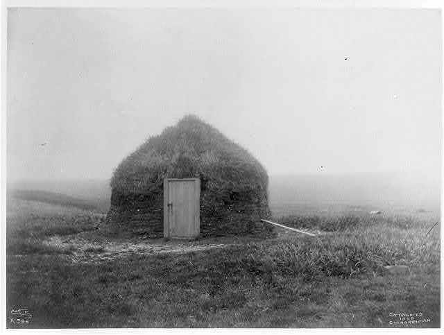 [Frontal view of earthen hut, Pribilof Islands, Alaska] / Curtis.