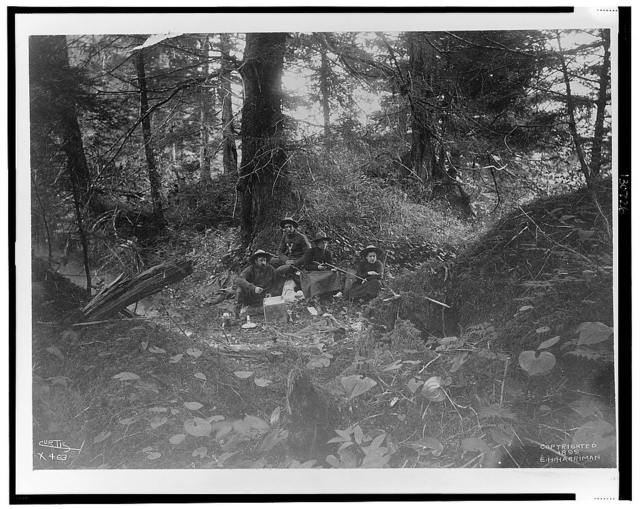 [Two men and two women seated in forest in Alaska, 1899] / Curtis.