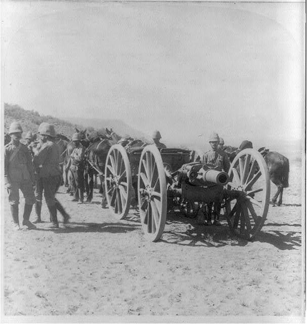 37th R.A. howitzer battery going to Maddox Hill to throw lyddite into the Boer Laager, S. Africa