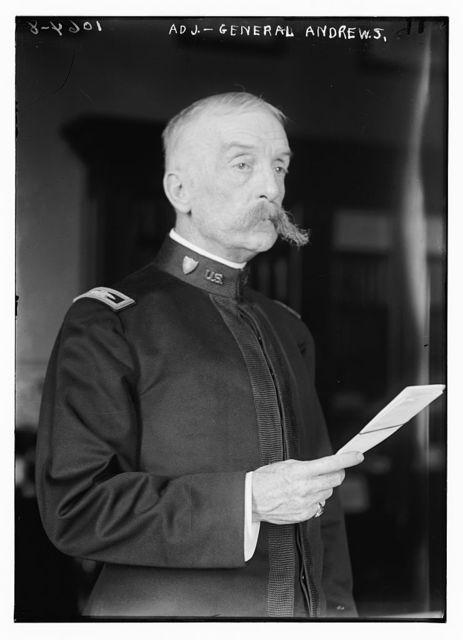 Adj. Gen. Andrews holding sheet of paper