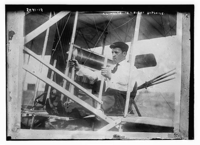 A.L. Welch in right biplane