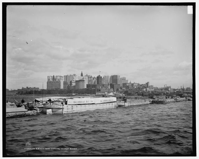 Albany tow coming in East River, An