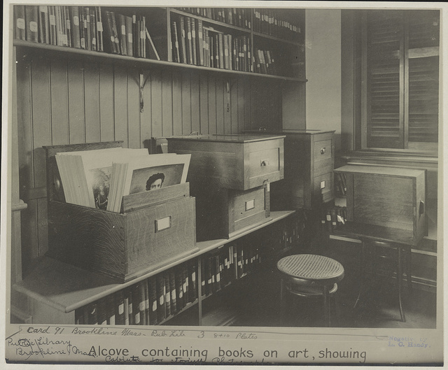 Alcove containing books on art, showing cabinets for storing photographs