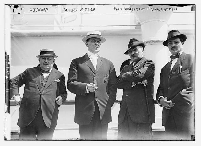 A.T. Worm, Wilson Mizner, Paul Armstrong, and Raoul Cincinell (left to right) standing